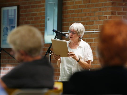 Sue Ruff of Binghamton speaks during the Community
