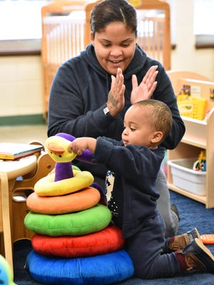 Jeneeda Lewis and her 22 month-old son Legend Lewis work on counting and comparing colors and numbers at the Pickens County Parenting and Family Literacy Center.