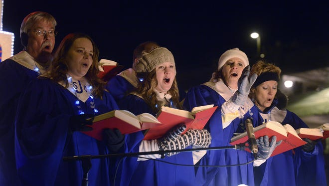 Singers from St Joseph's Christmas at The Cathedral perform during the 2012 Parade of Lights.