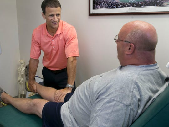Physical therapist Michael Santamaria, owner of Shore Physical Therapy, works with a patient in his Ocean Township office.