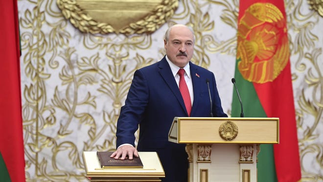Belarusian President Alexander Lukashenko takes his oath of office during his inauguration ceremony at the Palace of the Independence in Minsk, Belarus, Wednesday, Sept. 23, 2020. Lukashenko of Belarus has assumed his sixth term of office in an inauguration ceremony that wasn't announced in advance. State news agency BelTA reports that the ceremony will take place with several hundred top government official present.