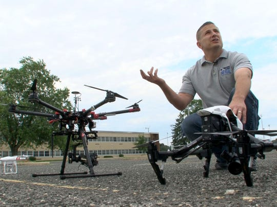 James Kosma, the owner of Shore Arieal Photography, is shown with three of his company's drones in the parking lot at the Emma Havens Young Elementary School in Brick Township Wednesday, July 12, 2017.