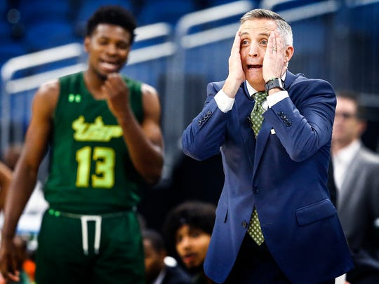 USF head coach Brian Gregory (right) reacts to an officials foul call during second half action against Memphis at the AAC tournament in Orlando, Fl., Thursday, March 8, 2018.