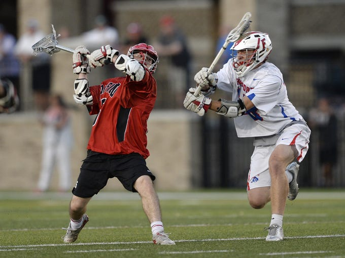 Penfield's Joey Barboza, left, winds up a shot on goal