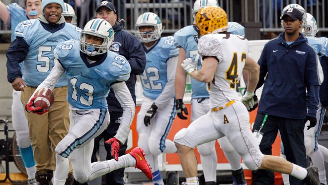 Cleveland Benedictine's Justin Layne, left, runs up the sidelines as Kettering Alter's Alex Wanamaker chases during the fourth quarter of the Division IV state high school football championship game at Ohio Stadium Friday, Dec. 5, 2014, in Columbus, Ohio. Benedictine beat Alter, 21-14.