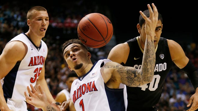 Arizona guard Gabe York (1) steals the ball from Colorado forward Josh Scott (40) during the first half of an NCAA college basketball game in the quarterfinald of the Pac-12 men's tournament Thursday, March 10, 2016, in Las Vegas.