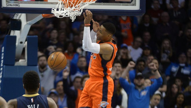 Russell Westbrook slams home two of his team-high 28 points.