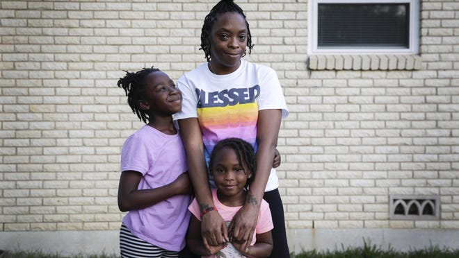 Imani Nembhard, 30, stands with her daughters Jurnii Nembhard, 9, and Jada Kae, 5, outside of their home in Killeen on Oct. 12. In 2019, Nembhard was thrown to the ground by Williamson County sheriff's Deputy Christopher Pisa after being pulled over for a traffic violation. Pisa was charged with assaulting Nembhard this month.
