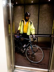 Bicycle commuter Guy Hackett heads into his office
