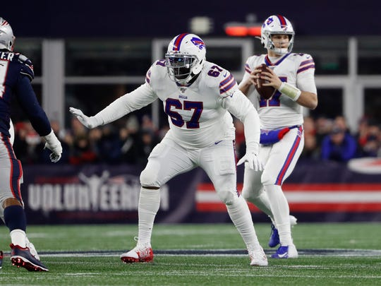 Quinton Spain (67), shown blocking against the New England Patriots last season, has agreed to a new three-year deal with the Buffalo Bills.