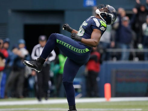 Seattle Seahawks defensive end Cliff Avril (56) celebrates after sacking New Orleans Saints quarterback Drew Brees during the third quarter of an NFC divisional playoff NFL football game in Seattle, Saturday, Jan. 11, 2014. Seattle Seahawks defensive