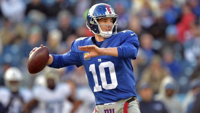 Giants quarterback Eli Manning throws a pass against the Tennessee Titans during the second half of Sunday's game. The Giants beat the Titans 36-7 to snap a seven-game losing streak.