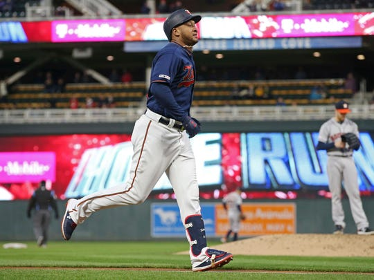 Minnesota Twins' Jonathan Schoop jogs home on a two-run home run off Houston Astros pitcher Collin McHugh, right, in the third inning of a baseball game Wednesday, May 1, 2019, in Minneapolis. (AP Photo/Jim Mone)