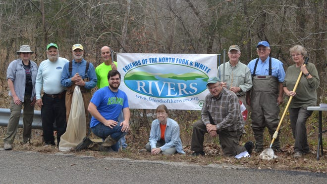From left, Kym Frantom, Lynn Green, Stream Team instructor, Friends of the Rivers members, Steve Blumreich, Dr. Eddie Dry, Bruce Burr, Tom Emerick, and Jane Darr. Front row, Gabriel Apple, ASUMH biology student and recipient of Friends of the Rivers scholarship, Pam Philips, member and Master Naturalist and Mike Jirka, member of Friends of the Rivers and Friends of the Norfork National Fish Hatchery.