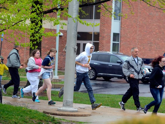 Students and teachers run from Red Land Senior High