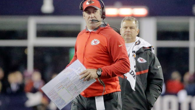 Former Kansas City Chiefs offensive coordinator Doug Pederson watches from the sideline in the first half of an NFL divisional playoff football game against the New England Patriots Jan. 16. The Eagles hired Pederson to be their coach.