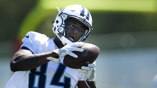 Titans wide receiver Corey Davis (84) pulls in a pass during training camp practice at Saint Thomas Sports Park on Sunday, July 30, 2017.