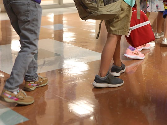 Students walk through the hallway at Lamar Elementary on the first day back to school for San Angelo ISD on Wednesday, Aug. 22, 2018.