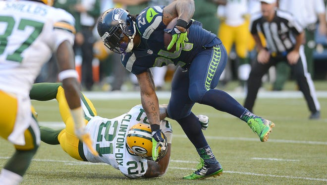Green Bay Packers safety Ha Ha Clinton-Dix (21) tries to tackle Seattle Seahawks running back Marshawn Lynch at CenturyLink Field September 4, 2014.