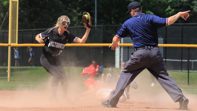 Plymouth senior Gina Barber holds up the softball as the Monroe runner is called out during Saturday's D1 regional final.