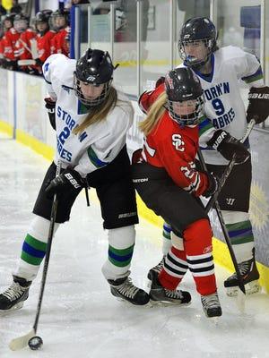 Sartell/Sauk Rapids' Joselyn Specht wrests the puck away from St. Cloud defenseman Anna Carlson on Jan. 26.
