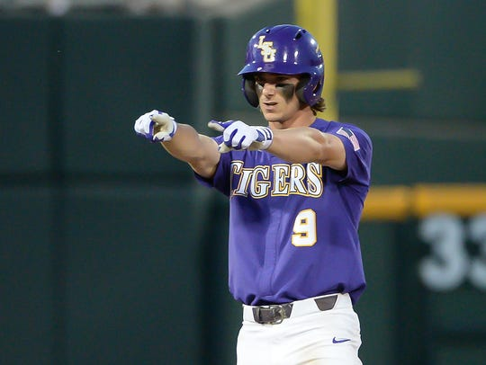 LSU's Zach Watson (9) had three hits and drove in two