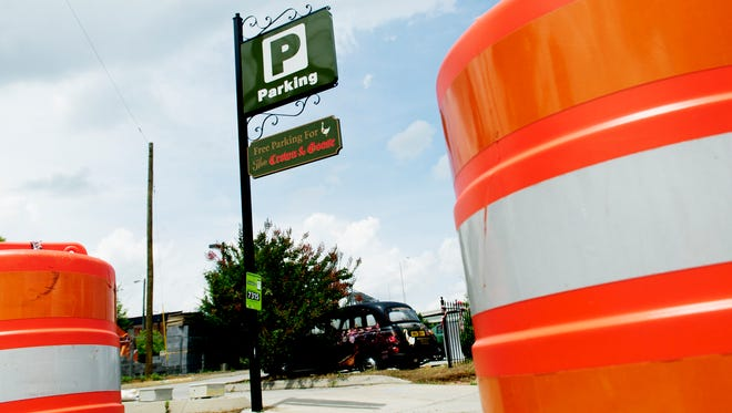 A street scene of the Crown and Goose parking lot in the Old City in Knoxville, Tennessee on Wednesday, July 5, 2017. The parking lot is planned to be developed into a six-story mixed-use development in the Old City.