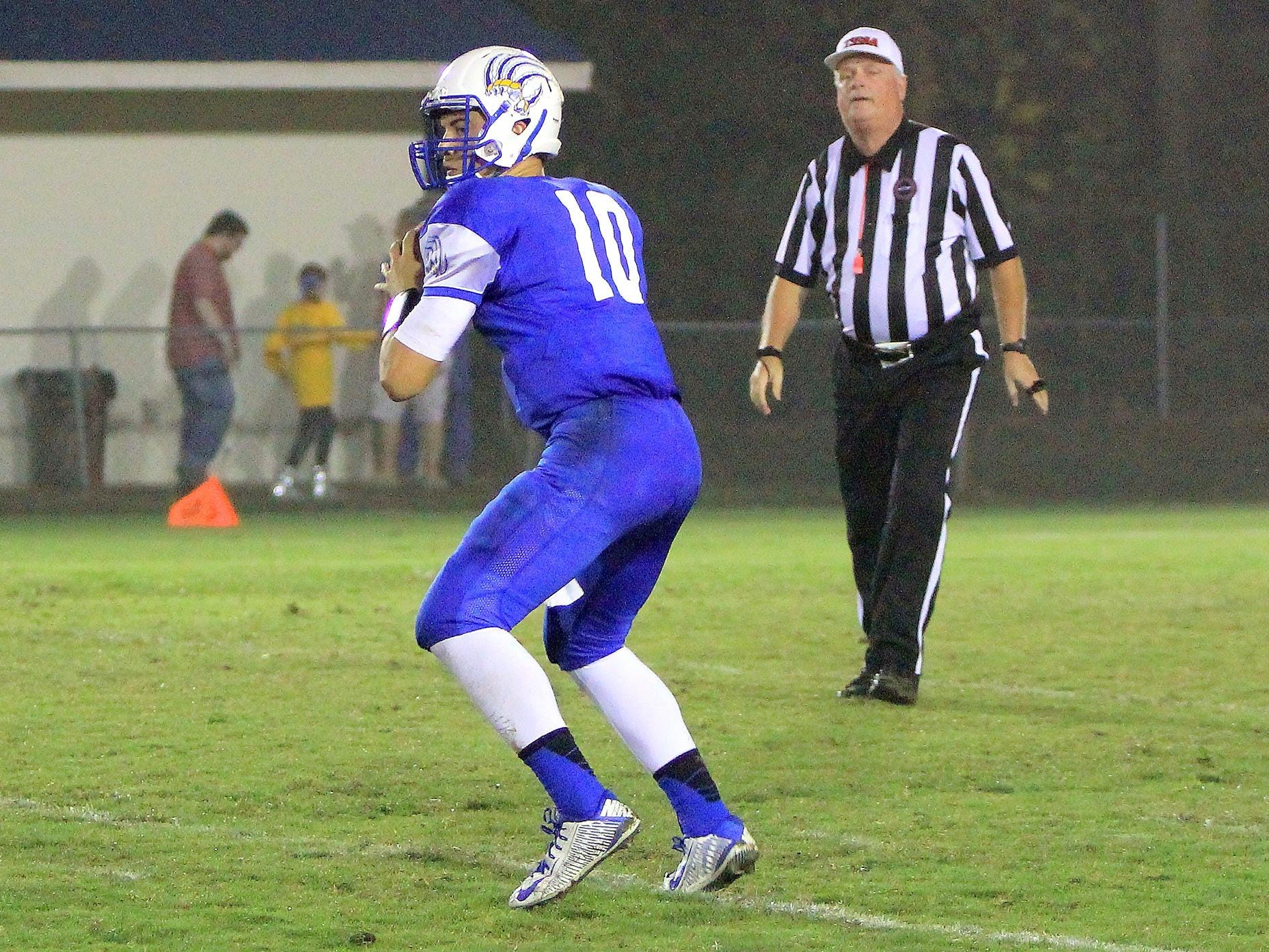 Drake Smith looks to pass during a 28-14 win over McNairy last season.