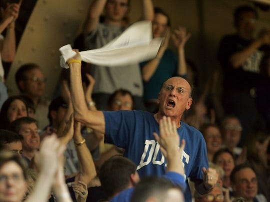 Herb Neubauer, also known as Crazy Towel Guy, gets the crowd going at Cameron Indoor Stadium in Durham, N.C.