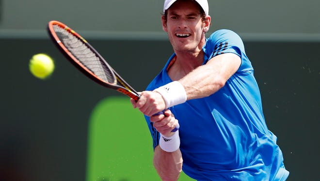 Andy Murray hits a backhand against Feliciano Lopez (not pictured) on day seven of the Sony Open at Crandon Tennis Center on March 23.