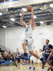 Cedar Crest's Evan Horn finishes a fast break after