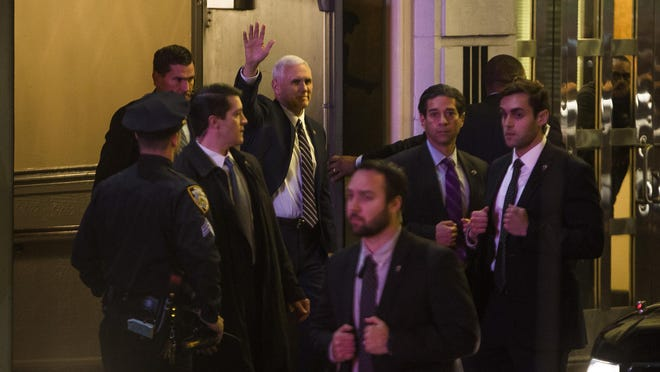 """Vice President-elect Mike Pence (top center), leaves the Richard Rodgers Theatre after a performance of """"Hamilton."""" Pence got a lecture from the cast after the performance."""