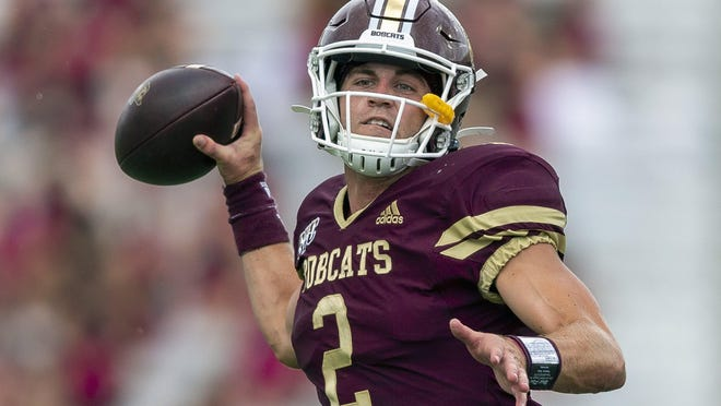 Texas State quarterback Brady McBride (2) looks for a receiver against SMU in September. McBride tied a school record with five touchdown passes in a win over Arkansas State on Saturday.