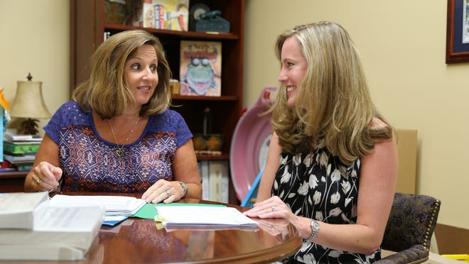 Concrete Primary School principal Sherry Padgett meets with PTSO co-president Heather McCormac to prepare for the start of the school year.