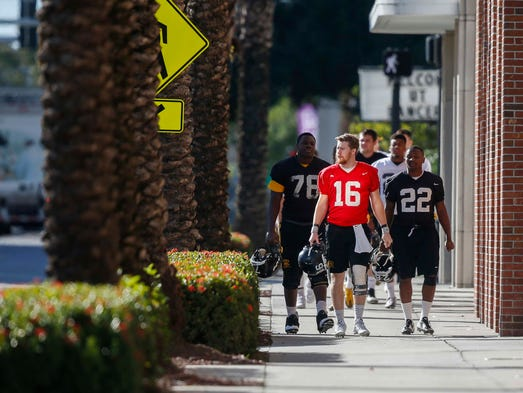 Iowa senior quarterback CJ Beathard leads a group of