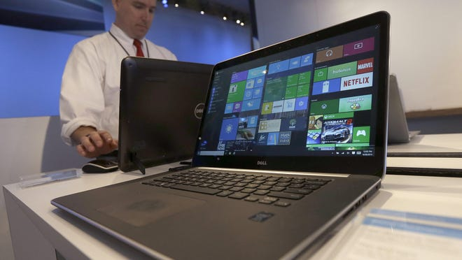 In this April 29 photo, a Dell laptop computer running Windows 10 is on display at the Microsoft Build conference in San Francisco. Microsoft's new Windows 10 operating system made its debut July 29, as the longtime leader in PC software struggles to carve out a new role in a world where people increasingly rely on smartphones, tablets and information stored online.