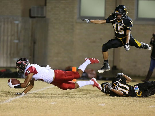 Menard's Brody Baugh (#15) leaps over his teammate