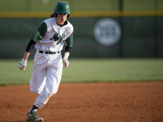 North's Seth Seniour (22) runs from second to third