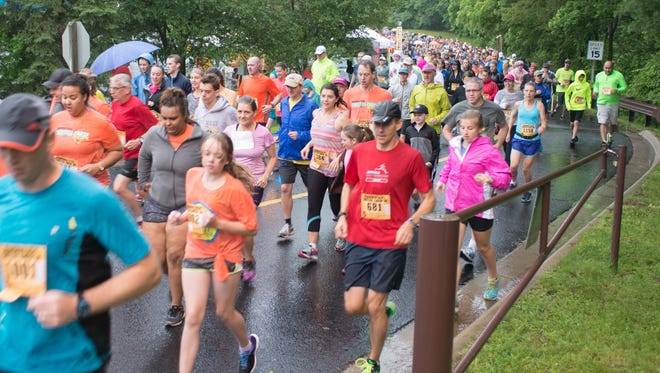 Runners begin the 2015 Cheetah Chase 5k event held at Binder Park Zoo.