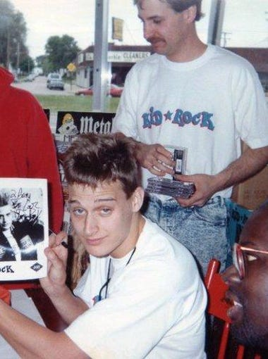 Kid Rock signing autographs at Record Time in Roseville in 1990, during the short period when he was signed to Jive Records.