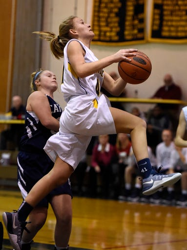 Elco Raider Julia Nelson drives to the hoop past a