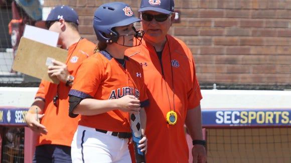Auburn junior Haley Fagan talking to Auburn coach Clint Myers before an at-bat in SEC Tournament quarterfinal 6-4 win over Alabama on May 13, 2016.