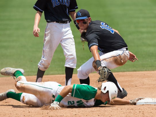 Wall's Dryden Virden is tagged out by Nacogdoches Central