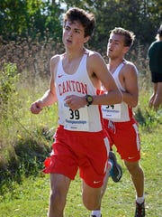 Canton's David Kight (left) and Braden Heimbaugh run
