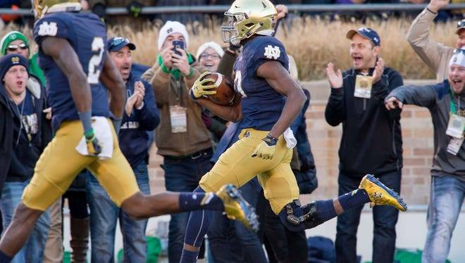 Josh Adams ran for a 98-yard touchdown in No. 6 Notre Dame's 28-7 win over Wake Forest.