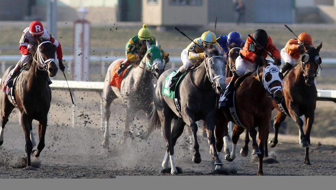Eventual 2014 Spiral Stakes winner We Miss Artie (far left) with John Velazquez aboard makes his move on the outside in the home stretch. The Battaglia Memoriala Stakes is a pre-race for the Spiral Stakes.