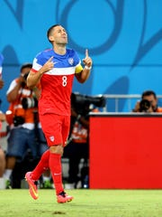 Clint Dempsey celebrates after scoring during the 2014 World Cup against Ghana.