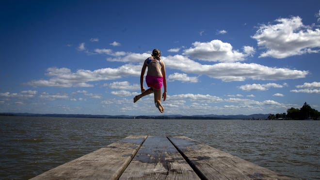 Madilyn Stockinger leaps into Fern Ridge Reservoir while visiting Richardson Park on Monday. The lake is a popular destination for those seeking a place to cool off and should see an abundance of visitors over the Fourth of July weekend. [Andy Nelson/The Register-Guard] - registerguard.com
