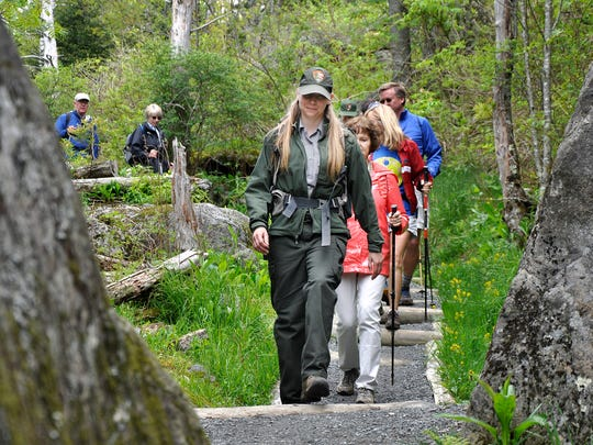 Smokies backcountry ranger Christine Hoyer leads a group hiking down the newly rehabilitated Forney Ridge Trail at the Great Smoky Mountains National Park in this 2015 photo.