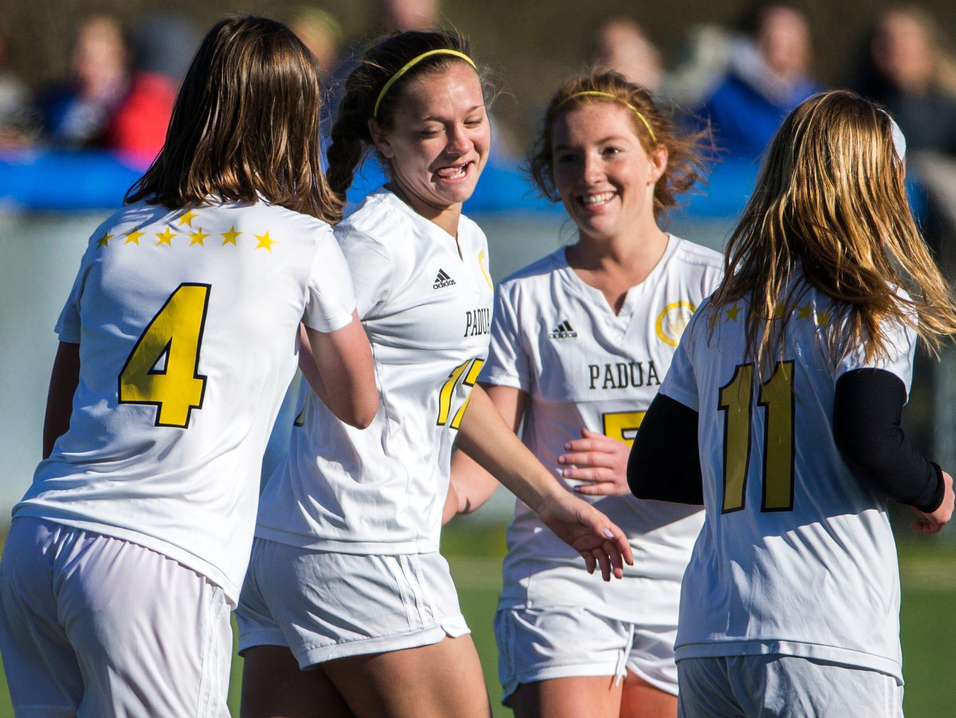 Padua's Lindsay Machamer (No. 17) celebrates with teammate Emilia Ryjewski (No. 4) after Ryjewski's goal in the second half of Padua's 2-0 win over Caesar Rodney at the Hockessin Soccer Club on Tuesday afternoon.